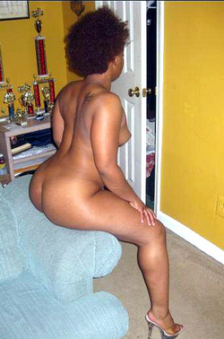 Elegant black woman, she is naked and..