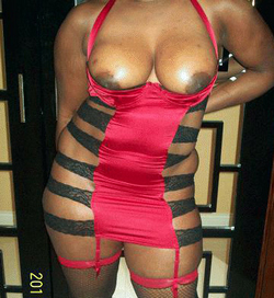 Mature ebony beauty in black stockings,..