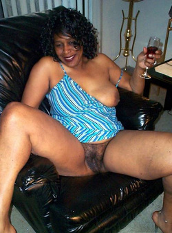 Naked black MILFs posing for their..